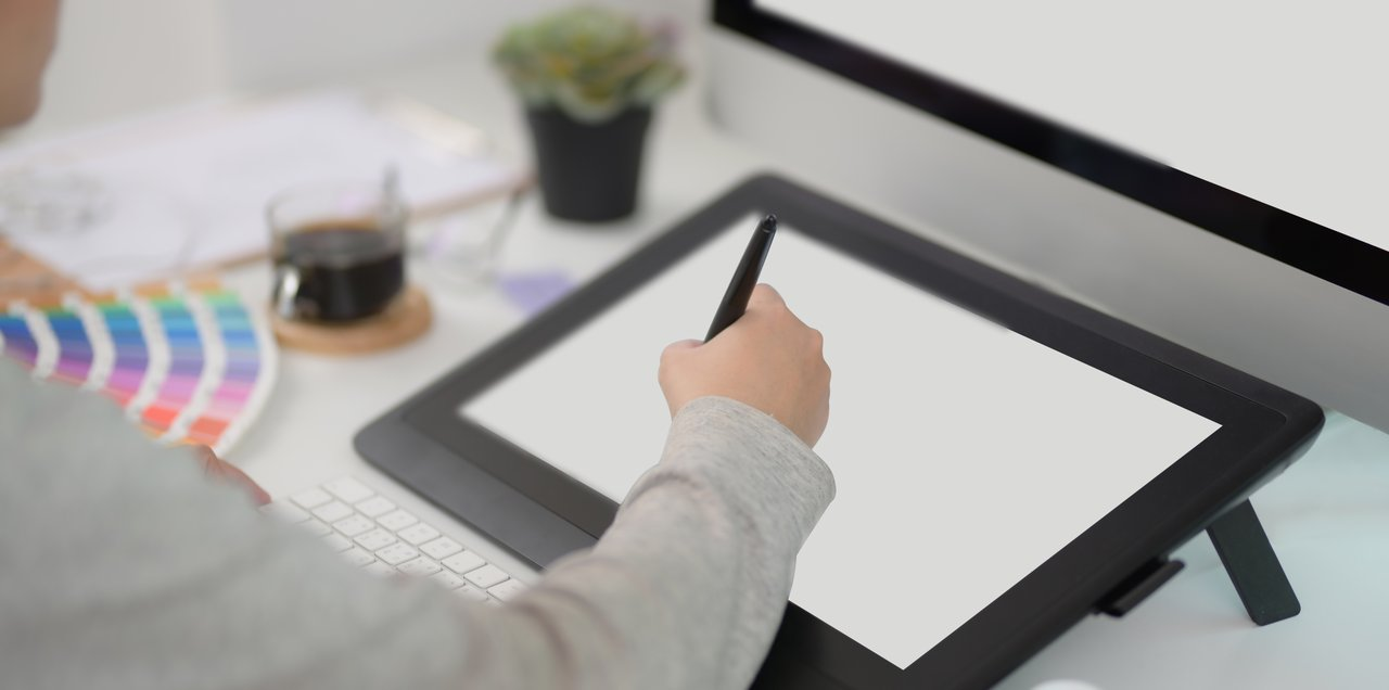 crop person using tablet in modern workplace