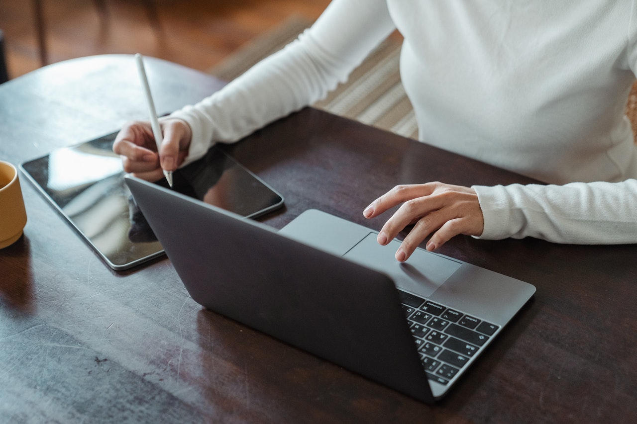 female entrepreneur multitask working on different devices