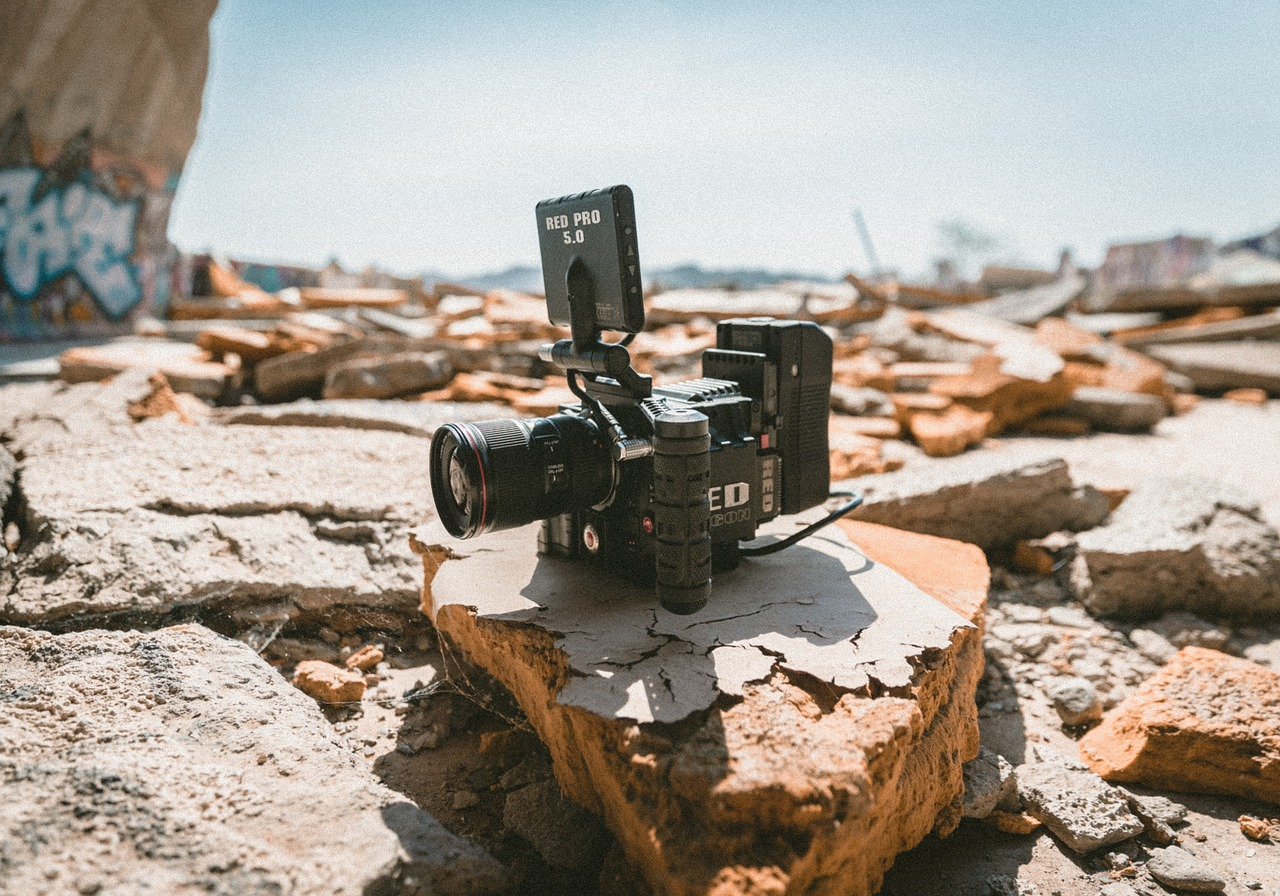 filmmaking camera isolated on rock outdoor during day time