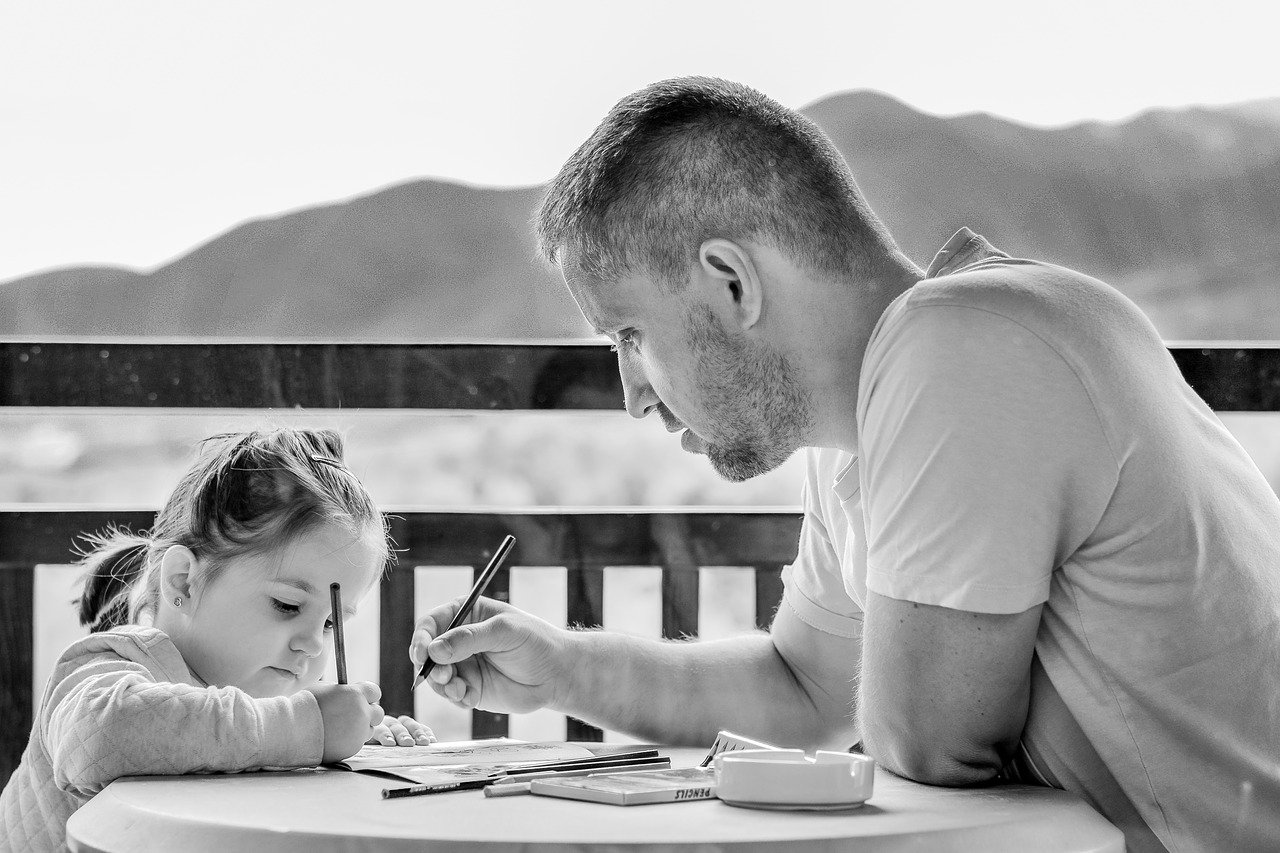 father teaching his girl outdoor