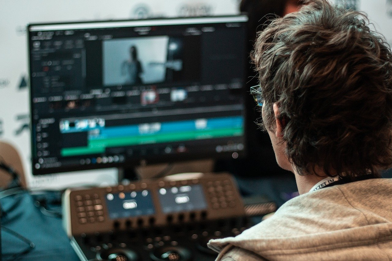 man editing video with video editing software