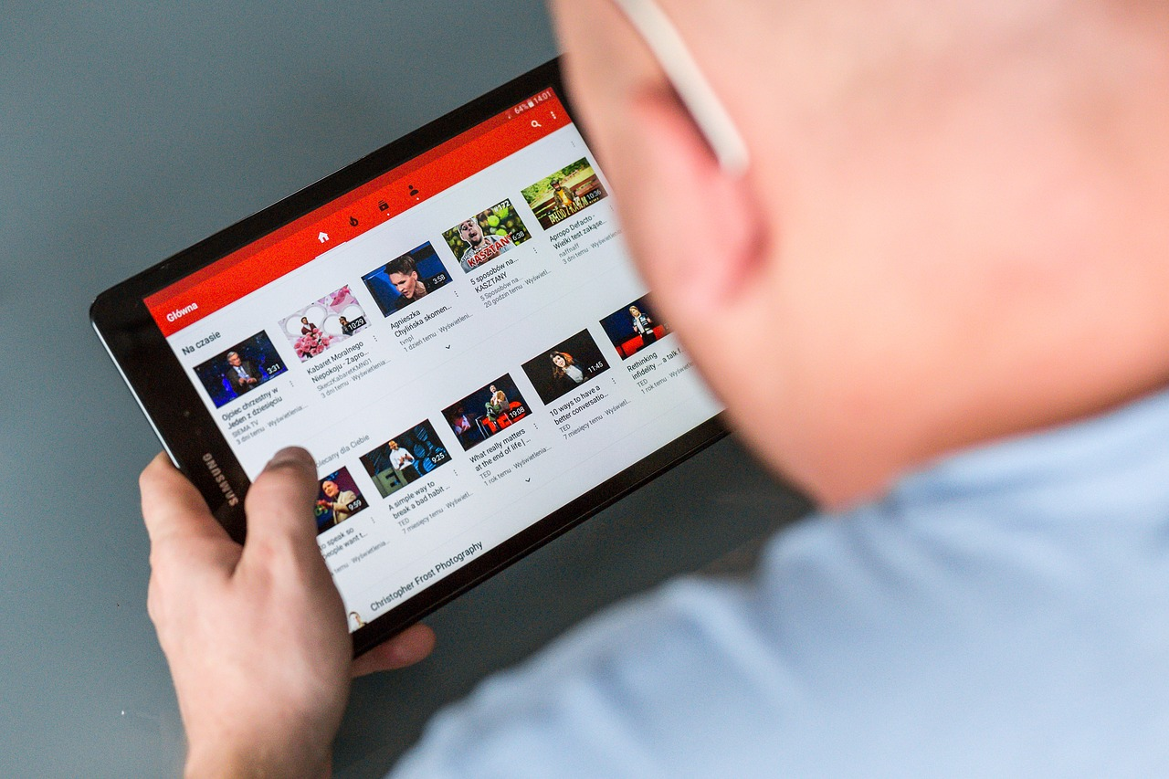 man using youtube in his samsung tablet