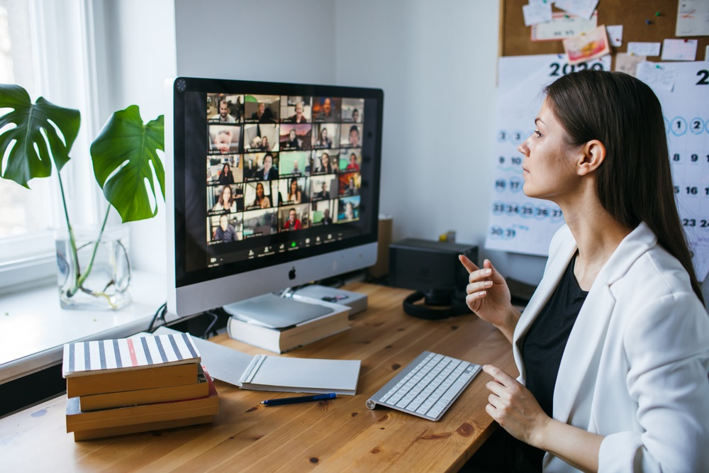 young woman having Zoom video conference call via computer